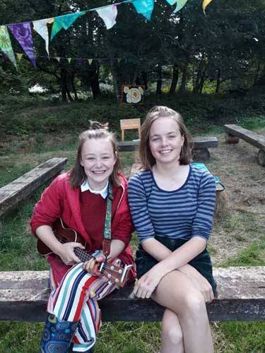 young girls sitting on a bench