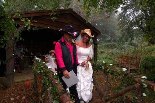 newly married couple leaving shack