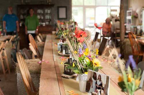 wooden table with lots of flowers on it