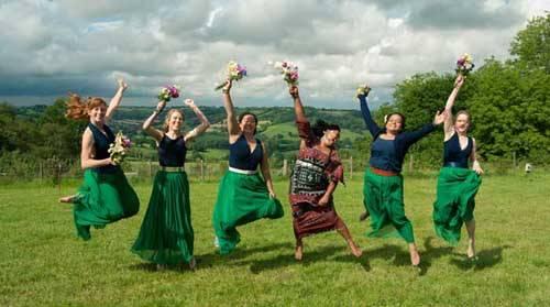 women cheering at wedding