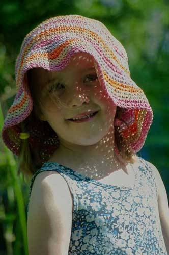 child with hat on