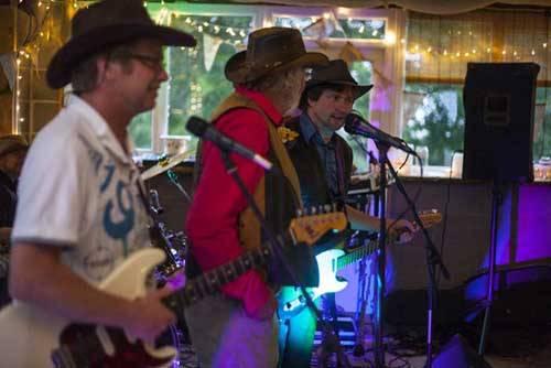 people playing guitars in barn