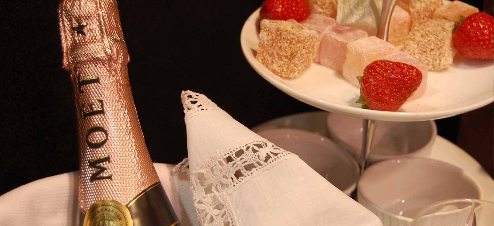 Moet Champagne next to dessert rack